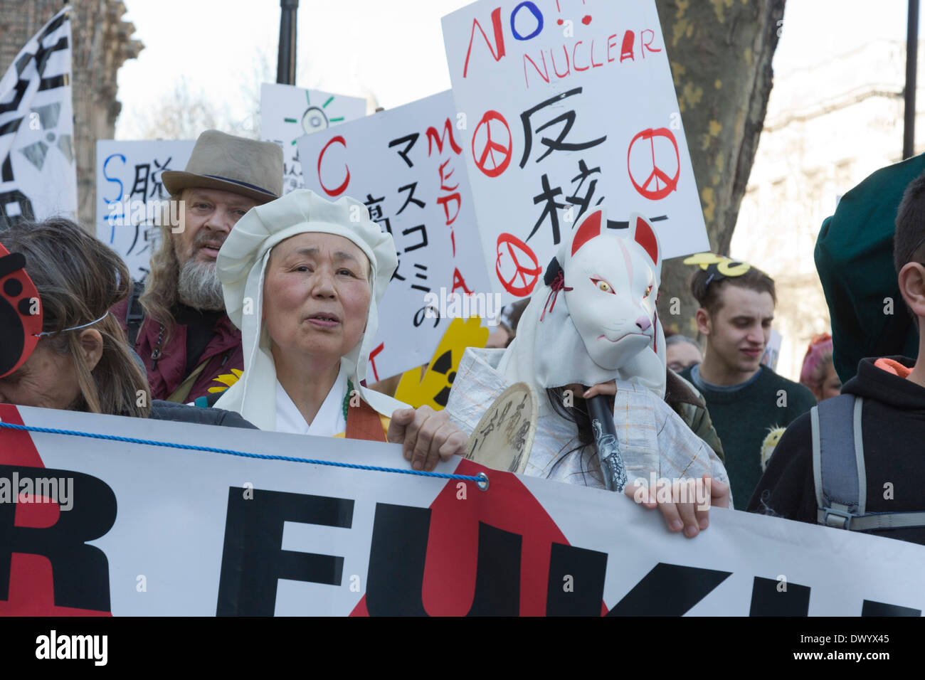 London, UK.  15 March 2014. Protest to remember the Fukushima Daiichi nuclear disaster. Japanese and British protesters called for an end to nuclear power on the 3rd anniversary of the nuclear disaster in Japan outside the gates to Downing Street, London. The protest was supported by 'Japanese Against Nuclear' and the Campaign for Nuclear Disarmament, CND. Credit:  Nick Savage/Alamy Live News - Stock Image