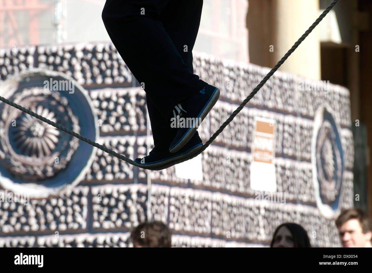 Busker on a tightrope, Bath, Somerset, England, UK - Stock Image