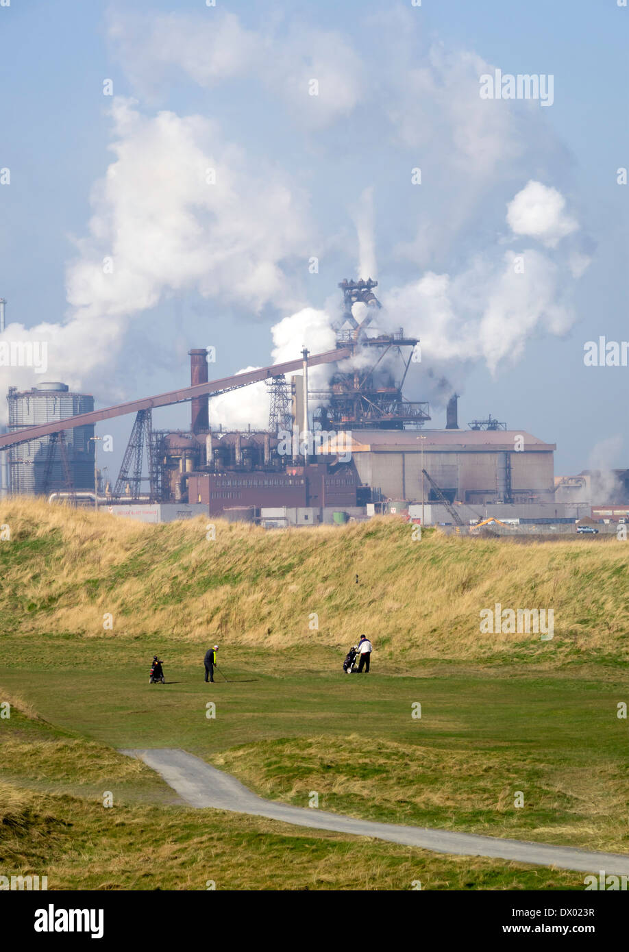 Redcar Blast Furnace of Thai company SSI steel works with Cleveland Golf Course in the foreground Stock Photo