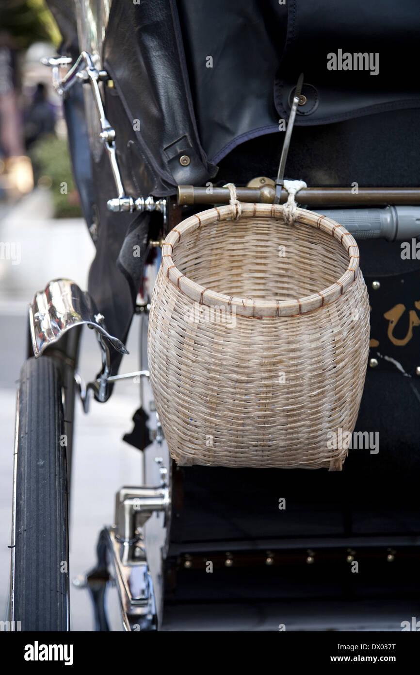 Basket hanging from rickshaw, Kamakura, Kanagawa Prefecture, Japan - Stock Image