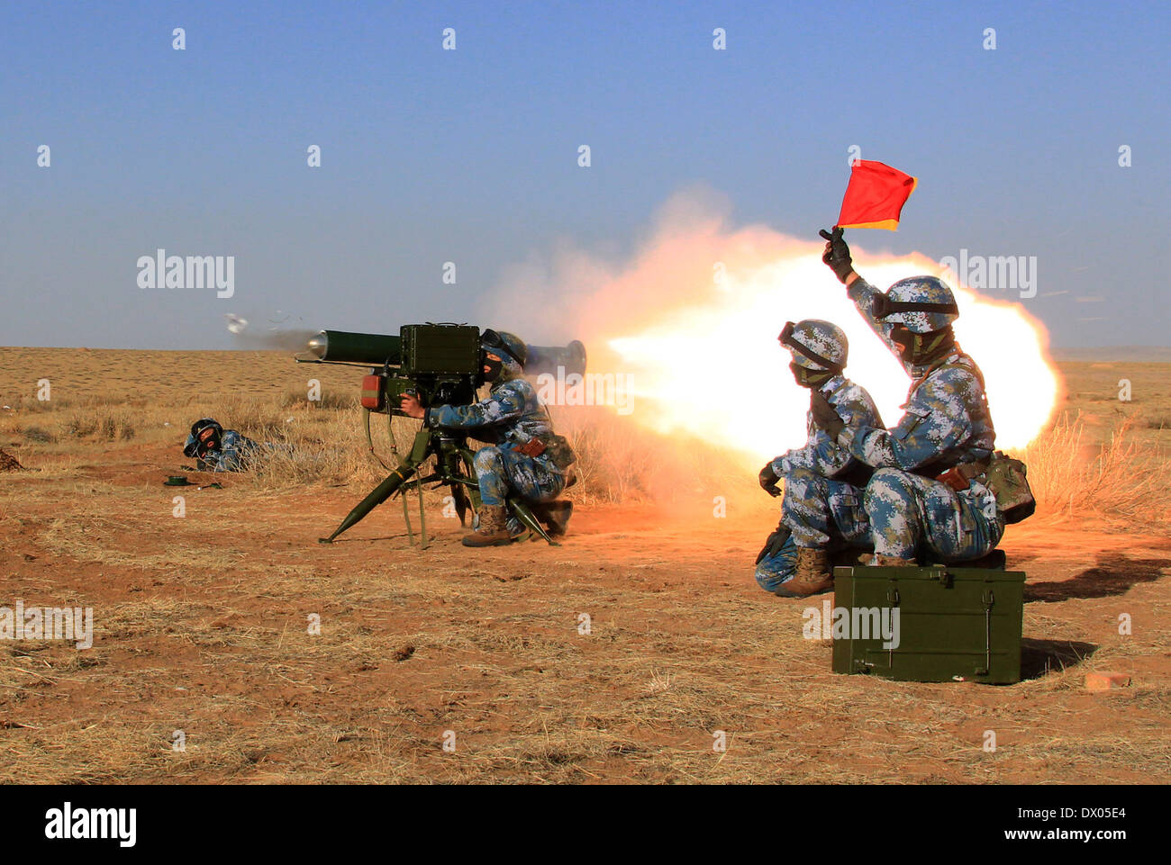 Hohhot. 15th Mar, 2014. Marines participate in a war game in north China's Inner Mongolia Autonomous Region, March 15, 2014. The marine corps with the Chinese navy on Friday concluded the war game to practise combat abilities in cold environments, according to military sources. Credit:  Zha Chunming/Xinhua/Alamy Live News - Stock Image