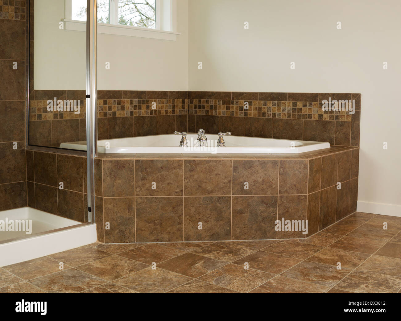 Horizontal photo of soaking tub in master bathroom with partial ...