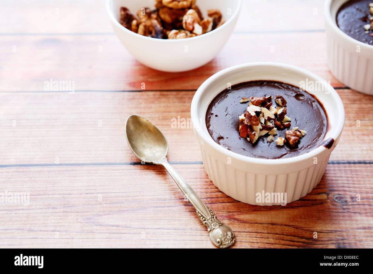 chocolate mousse with walnut pieces, food closeup - Stock Image
