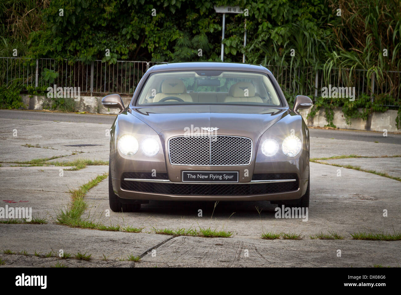 Bentley The New Flying Spur 2013 Model with Golden Brown Color - Stock Image