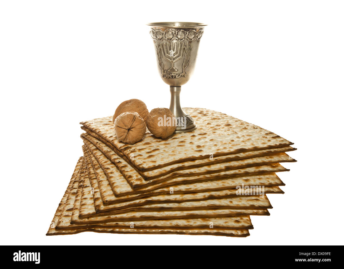 Matzoth, silver Kiddush cup and walnuts for Passover seder - Stock Image
