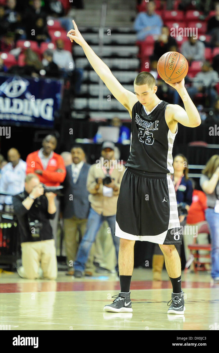 MAR 16, 2014 : Oakdale's Zach Thomas (23) motions to his friends and schoolmates after a crushing loss to Potomac Wolverines at the State 2A Basketball Championships at Comcast Center at University of Maryland. Oakdale was defeated by Potomac 64-51. - Stock Image