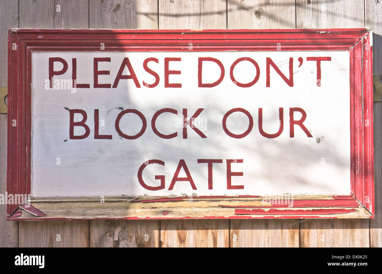 A sign on a home gate asking public not to block the gateway Stock Photo