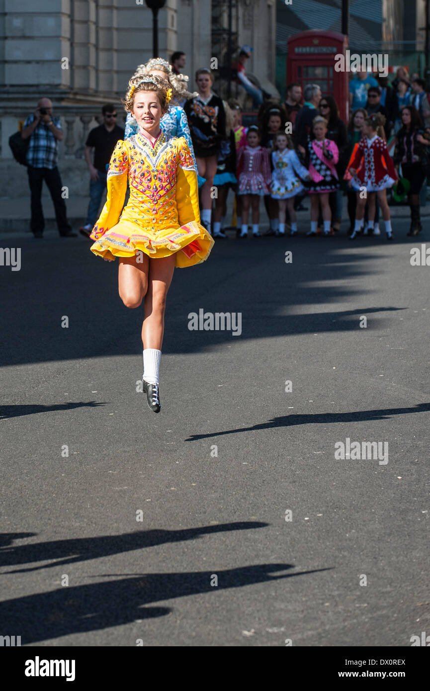 London, UK. 16 March 2014. A girl celebrates St Patrick's Day by dancing during the annual parade in London.   Photographer:  Gordon Scammell/Alamy Live News - Stock Image