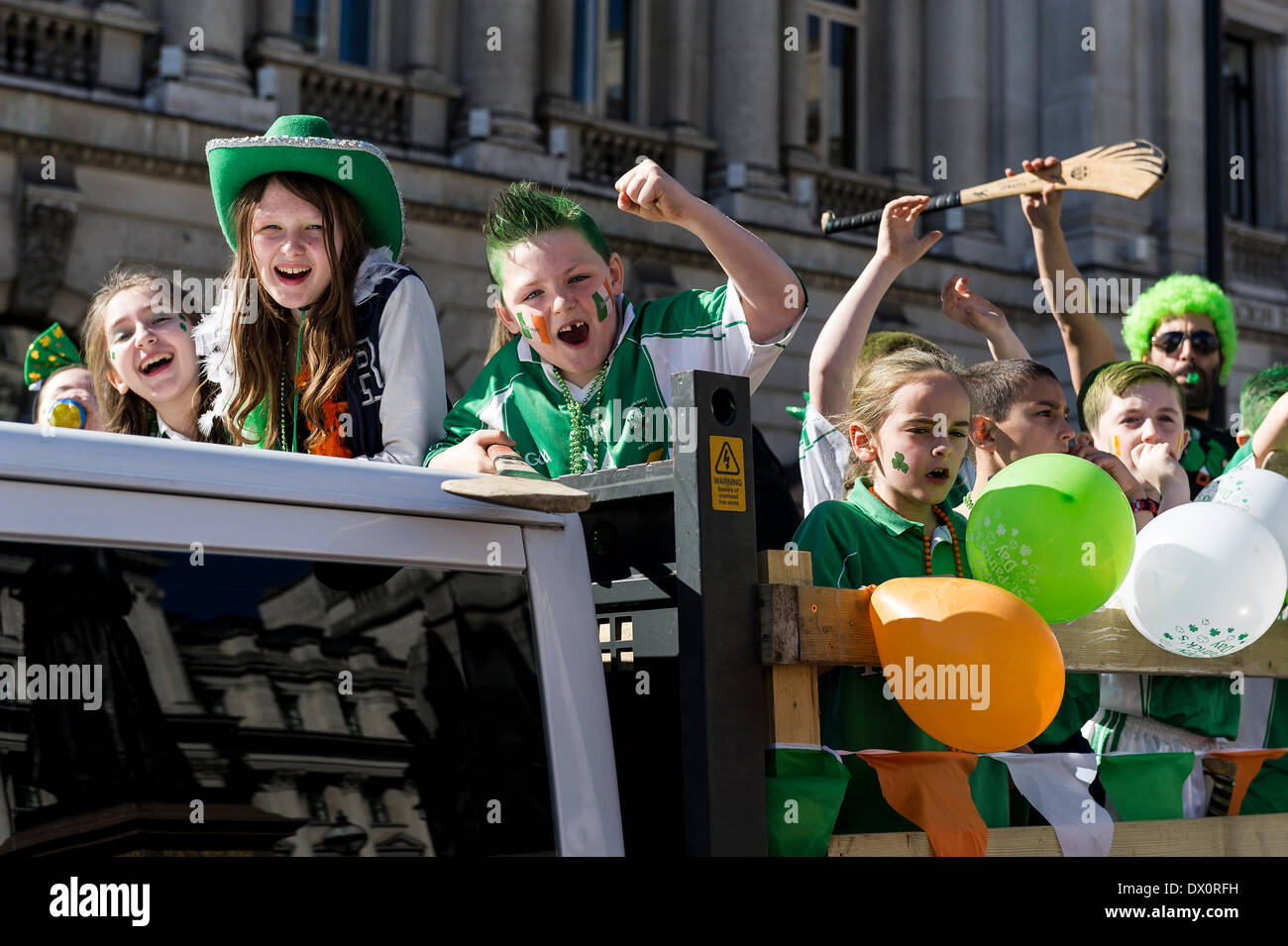London, UK. 16 March 2014. Children enjoying the annual St Patrick's day parade in London; Photographer:  Gordon Scammell/Alamy Live News - Stock Image