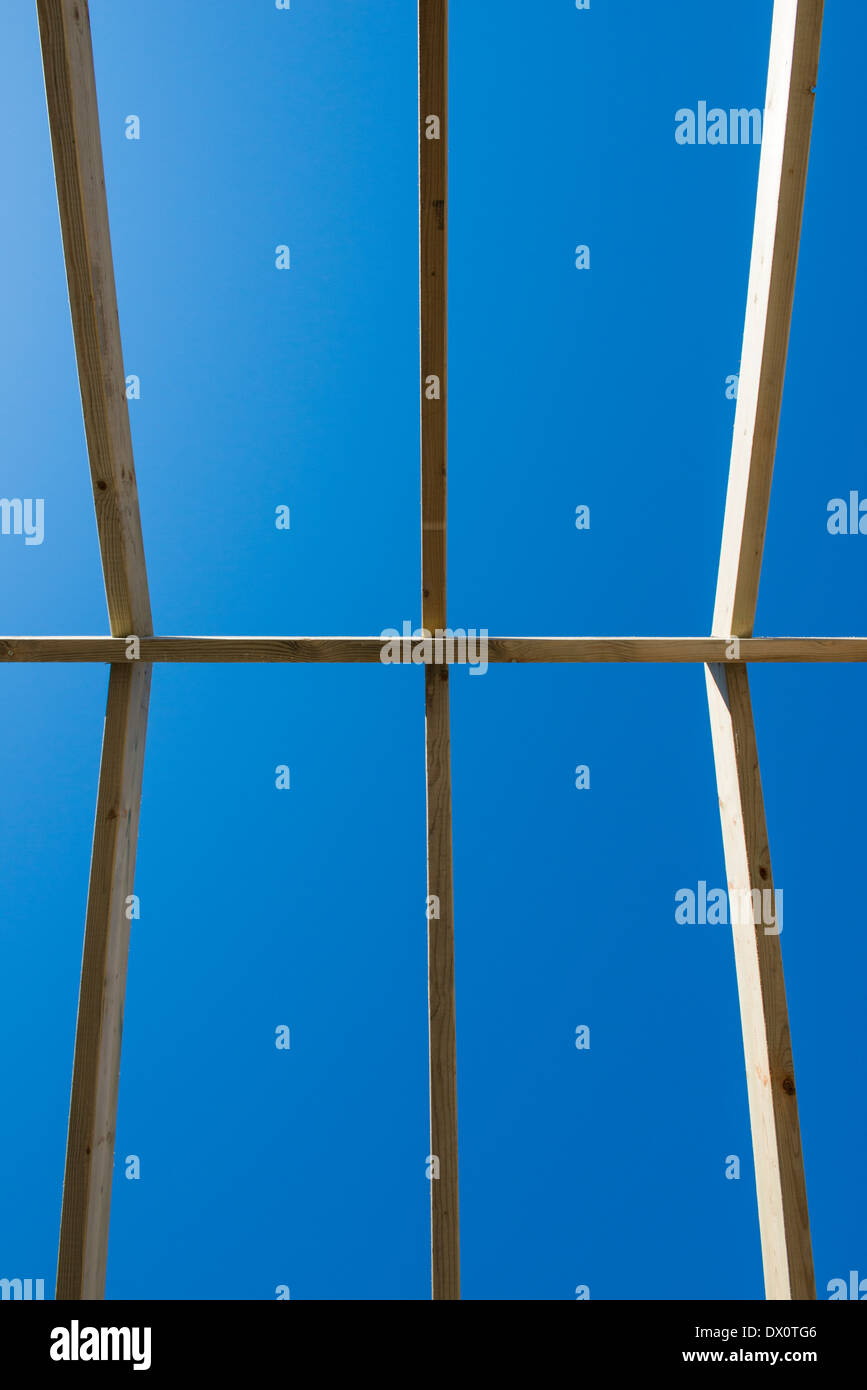 A roof under construction on a house. - Stock Image