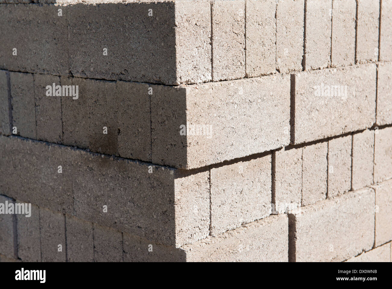 A pile of breeze blocks on a construction site - Stock Image