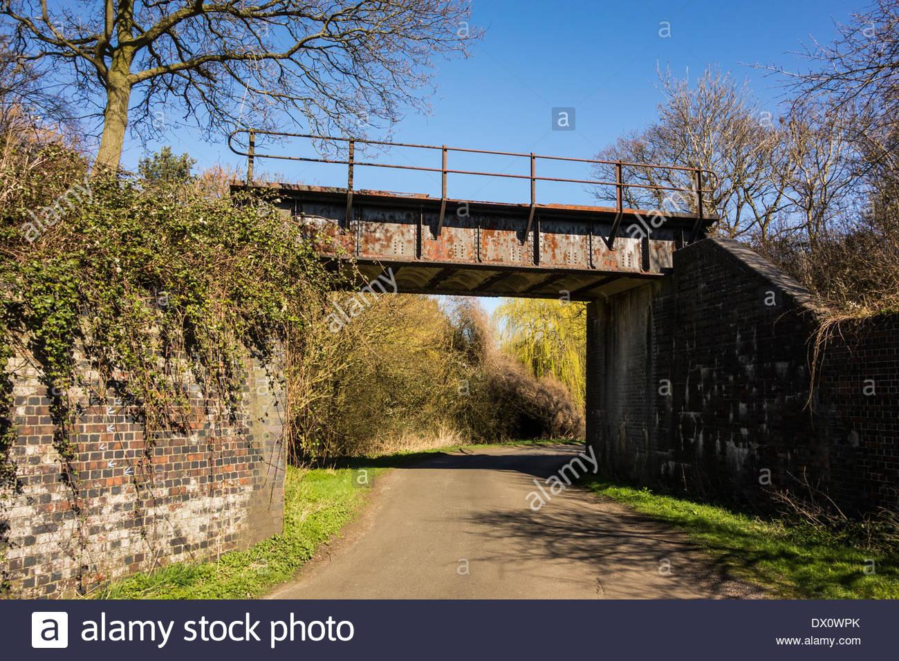 Bridge, now redundant, for the disused railway line between Huntingdon and Kettering, England, UK - Stock Image