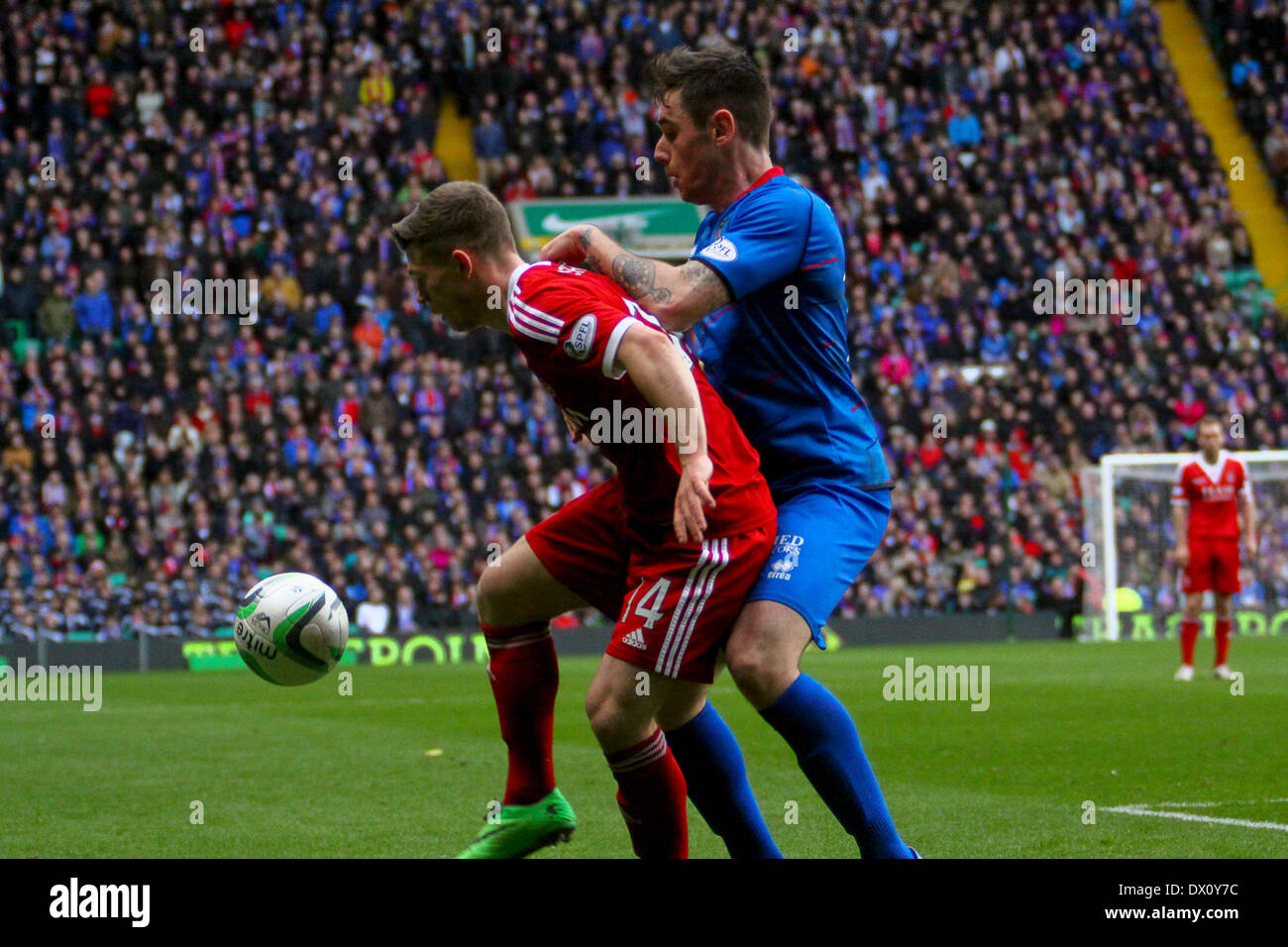 Glasgow, Scotland. 16th Mar, 2014. AFC sub Cammy Smith blocks ICT's Greg Tansey during the Scottish League Cup Final between Aberdeen FC and Inverness Caledonian Thistle FC at Celtic Park. Aberdeen won 4-2 on penalties. Credit:  Action Plus Sports/Alamy Live News - Stock Image