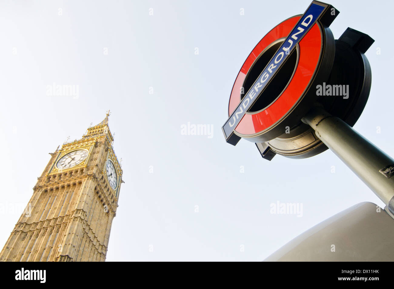 London, UK - April 30, 2011: Big Ben and The Roundel, logo of the Underground Tube transport in London or TFL. - Stock Image