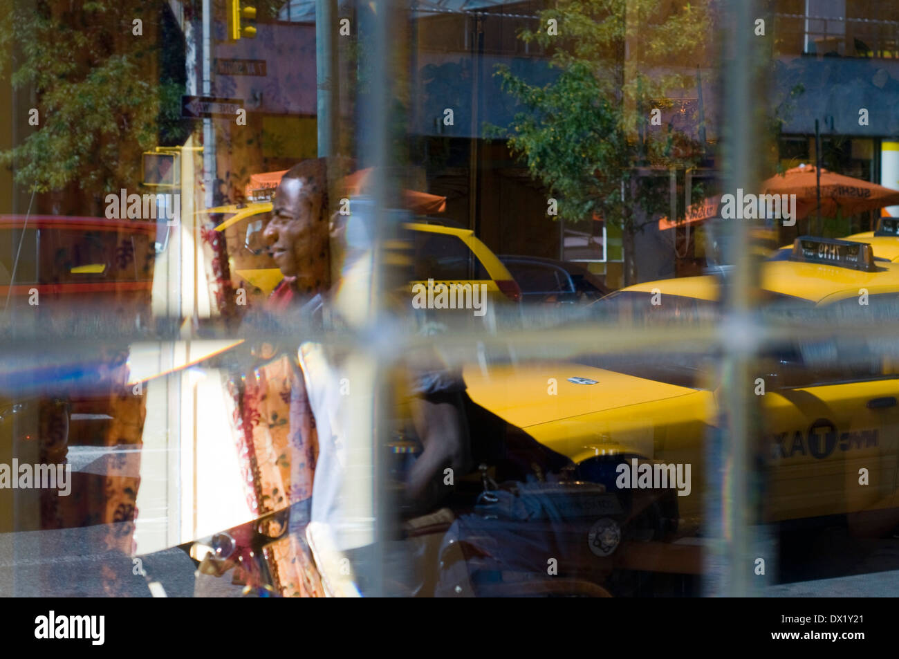 Reflection in a Greenwich Village shop. A residential neighborhood with small houses and interesting to eat or walk areas. - Stock Image