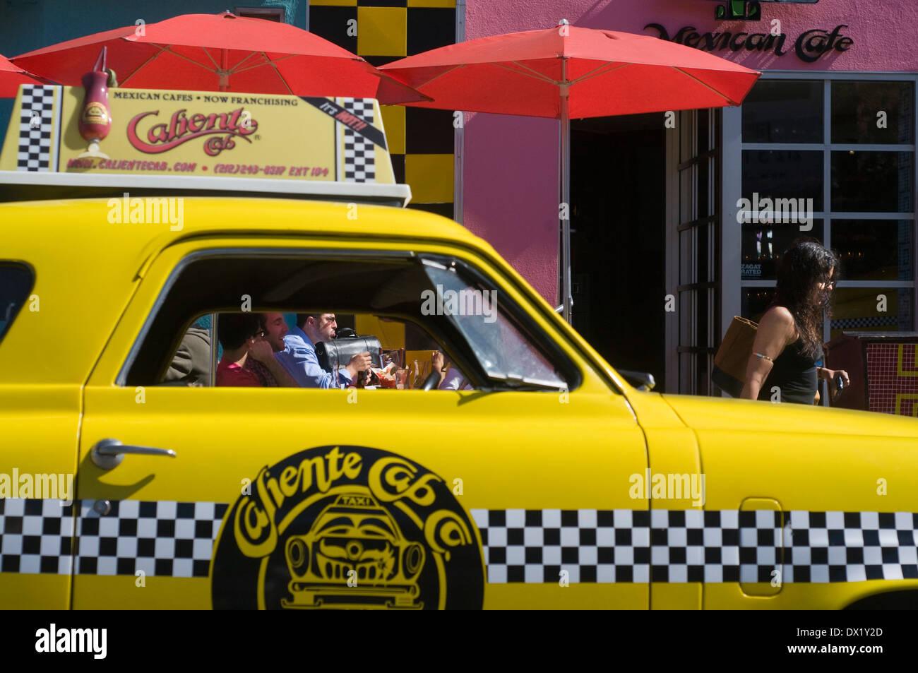 Caliente Cab Restaurant in Greenwich Village. 61 7th Avenue . (from 12:00 p.m. to 2:00 a.m. ) U.S. $ 7-20 . A yellow cab 50s - Stock Image