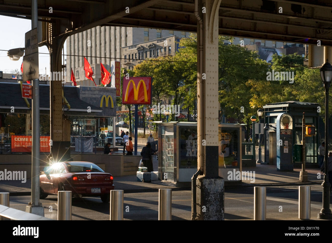 Typical landscape in the Bronx near a Mc Donnalds with elevated metro. Bronx Thinking nothing can make us imagine some friendly - Stock Image