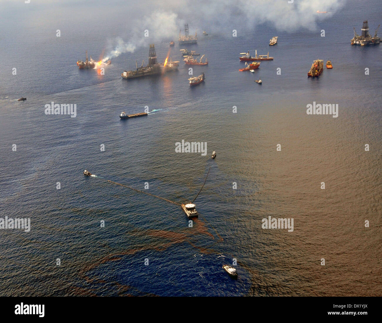 Oil skimming vessels operate around the the site of the Deepwater Horizon disaster as drill ship Discoverer Enterprise burns off gas from the wellhead June 26, 2010 in the Gulf of Mexico. - Stock Image
