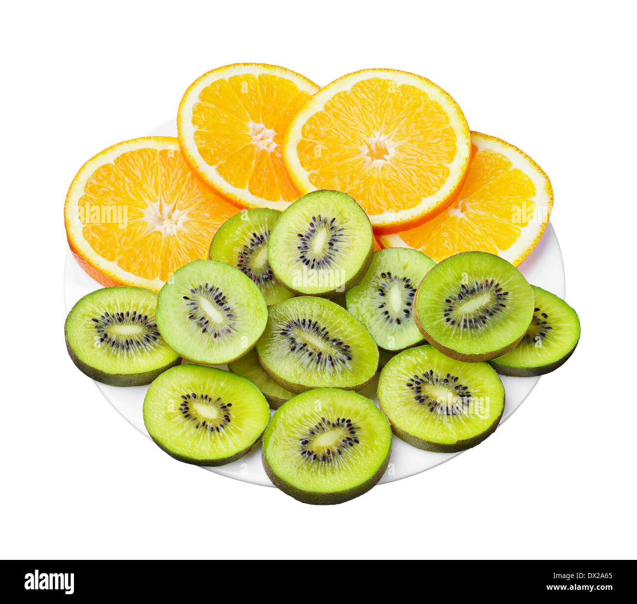 Kiwi and orange slices on a plate isolated on white - Stock Image