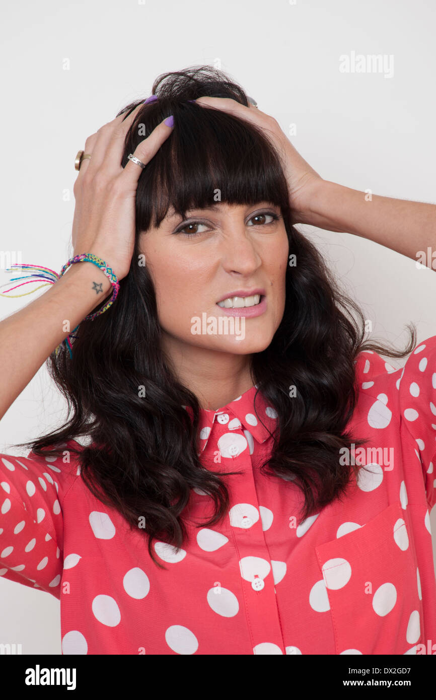 dark hair woman stressed anger - Stock Image