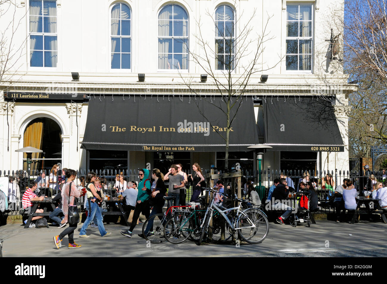 People outside The Royal Inn on the Park on a warm day, London Borough of Hackney, England UK - Stock Image