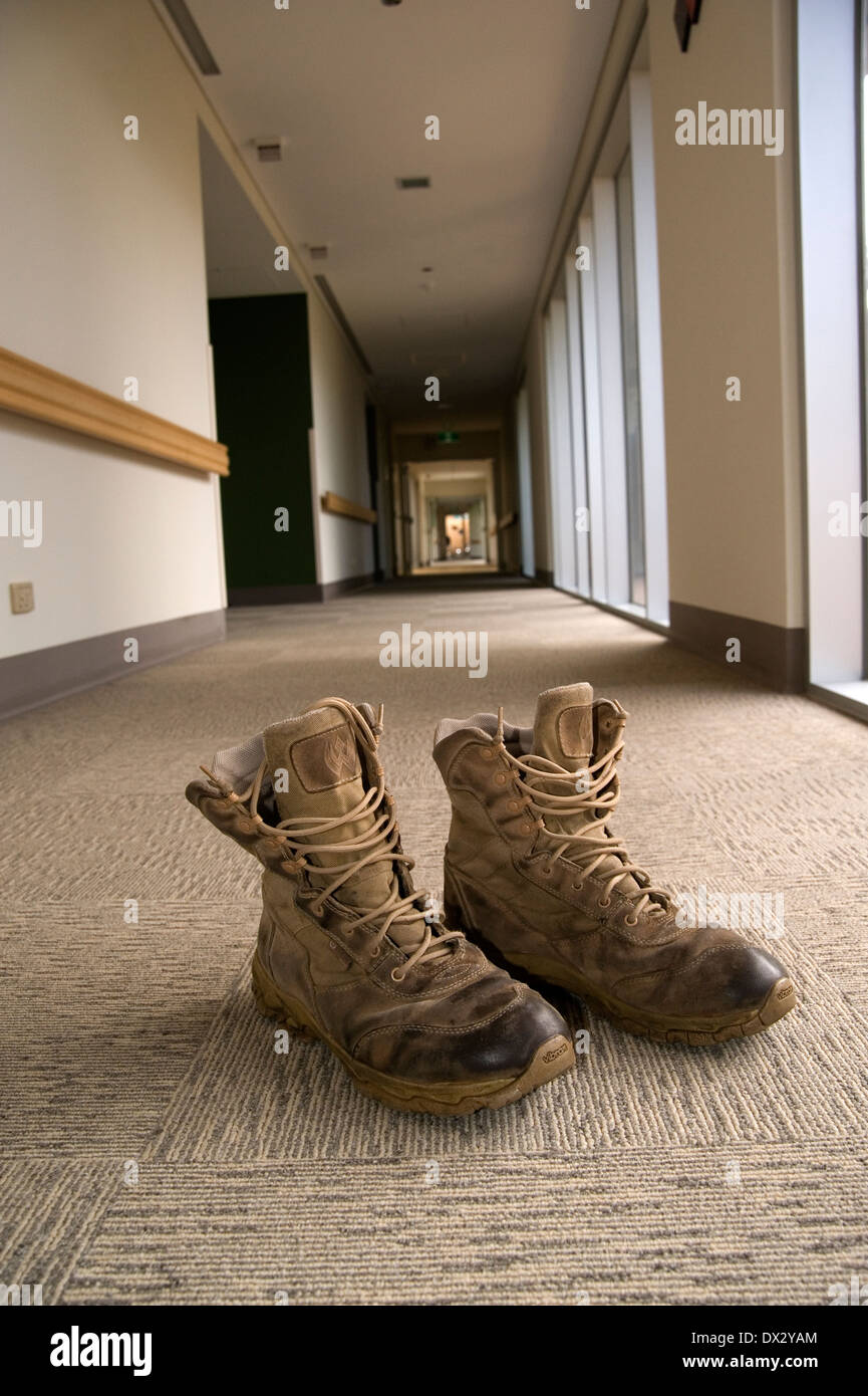 Army boots in hospital ward - Stock Image