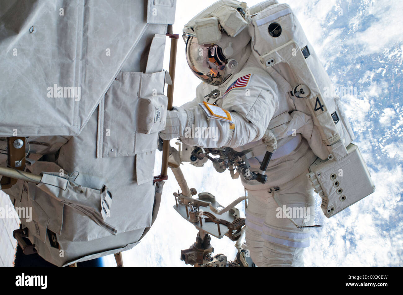 NASA astronaut Mike Hopkins takes part in the second of two spacewalks to change out a faulty water pump on the Stock Photo