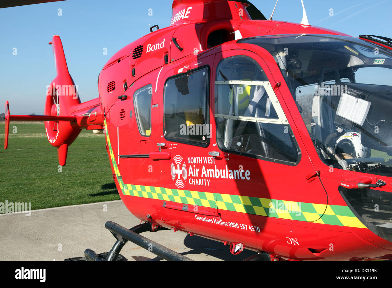one of the three North West Air Ambulances, a red Eurocopter EC135 helicopter aircraft operated by Bond Air Services - Stock Image