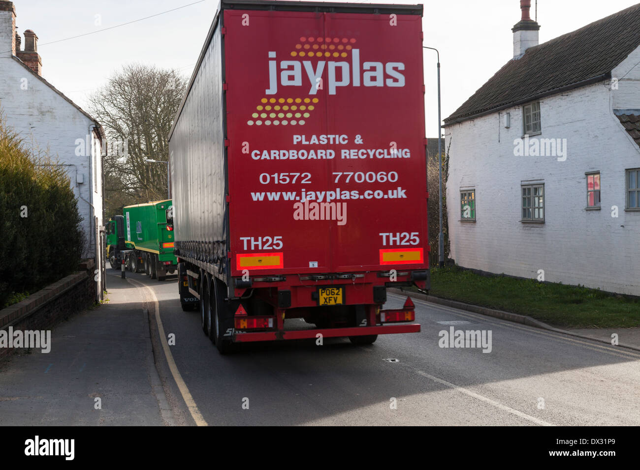 HGV lorry passing by houses on a road in the village of Rempstone, Nottinghamshire, England, UK - Stock Image