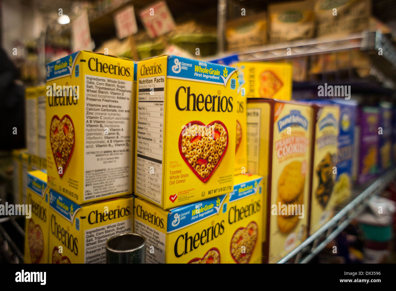 Single-serving breakfast sized boxes of General Mills Cheerios breakfast cereal in a grocery store in New York - Stock Image