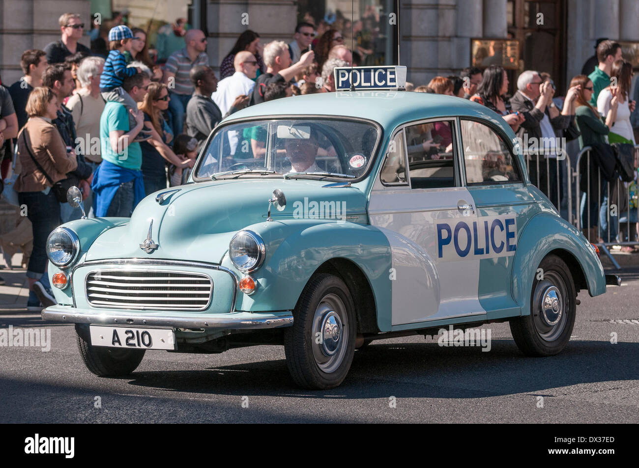 Waterloo Place, London, UK, 16 March 2014 - the annual St. Patrick's Day parade took place in bright sunshine in front of thousands of people who lined the route.  A vintage Morris Minor police car takes place in the parade. Credit:  Stephen Chung/Alamy Live News Stock Photo