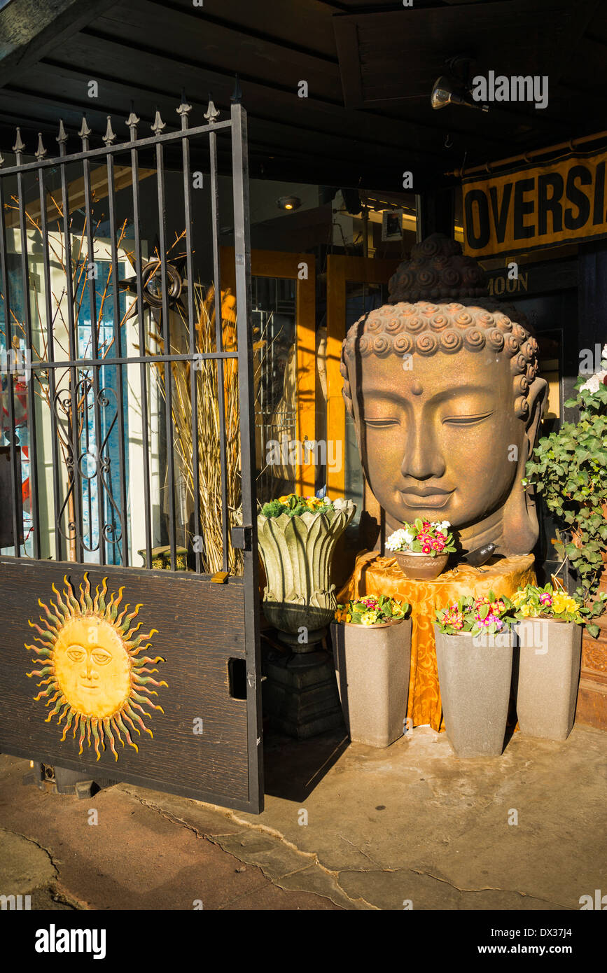 Buddha figure at Antique store entrance, - Stock Image