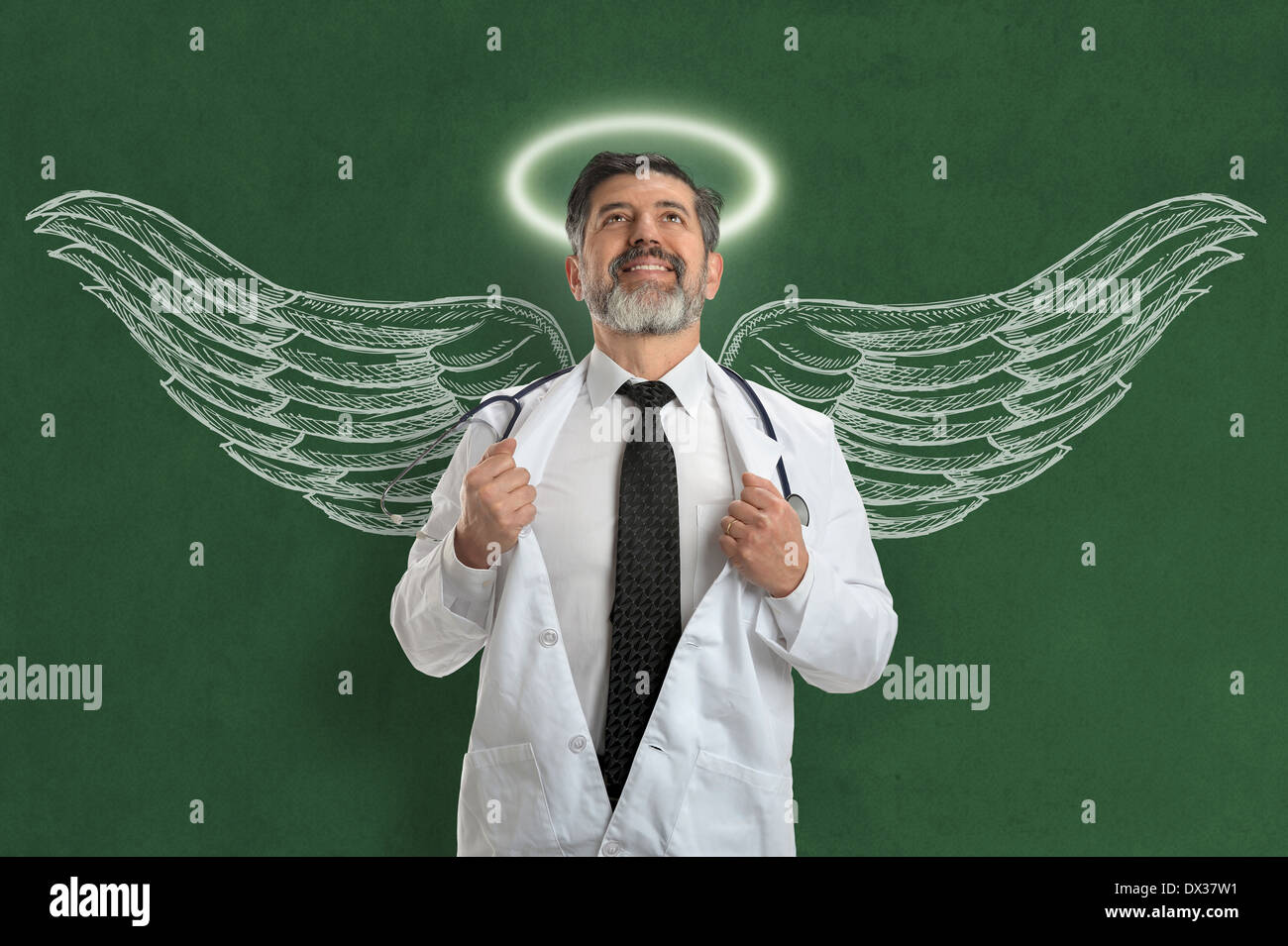 Hispanic doctor with angel wings and halo looking upwards - Stock Image