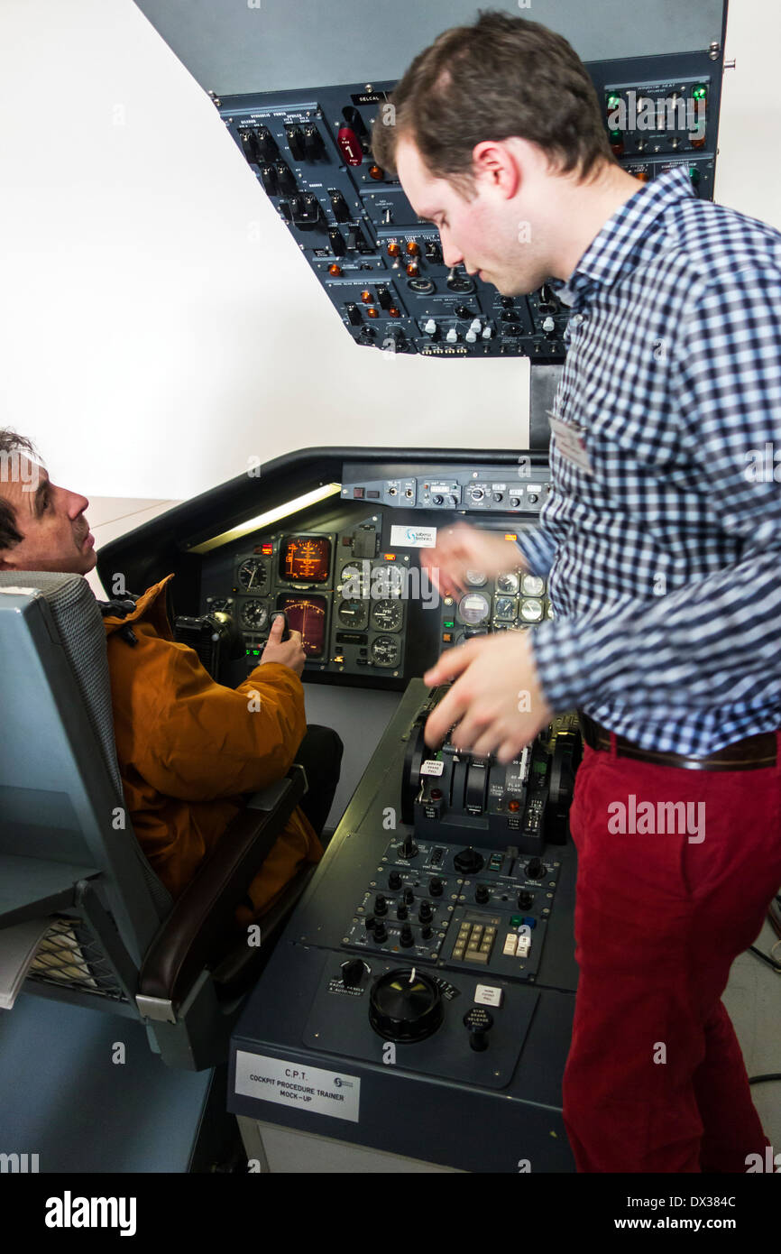 Student in CPT / mock-up cockpit procedure trainer at the VLOC / Flemish aviation training center in Ostend, Belgium - Stock Image