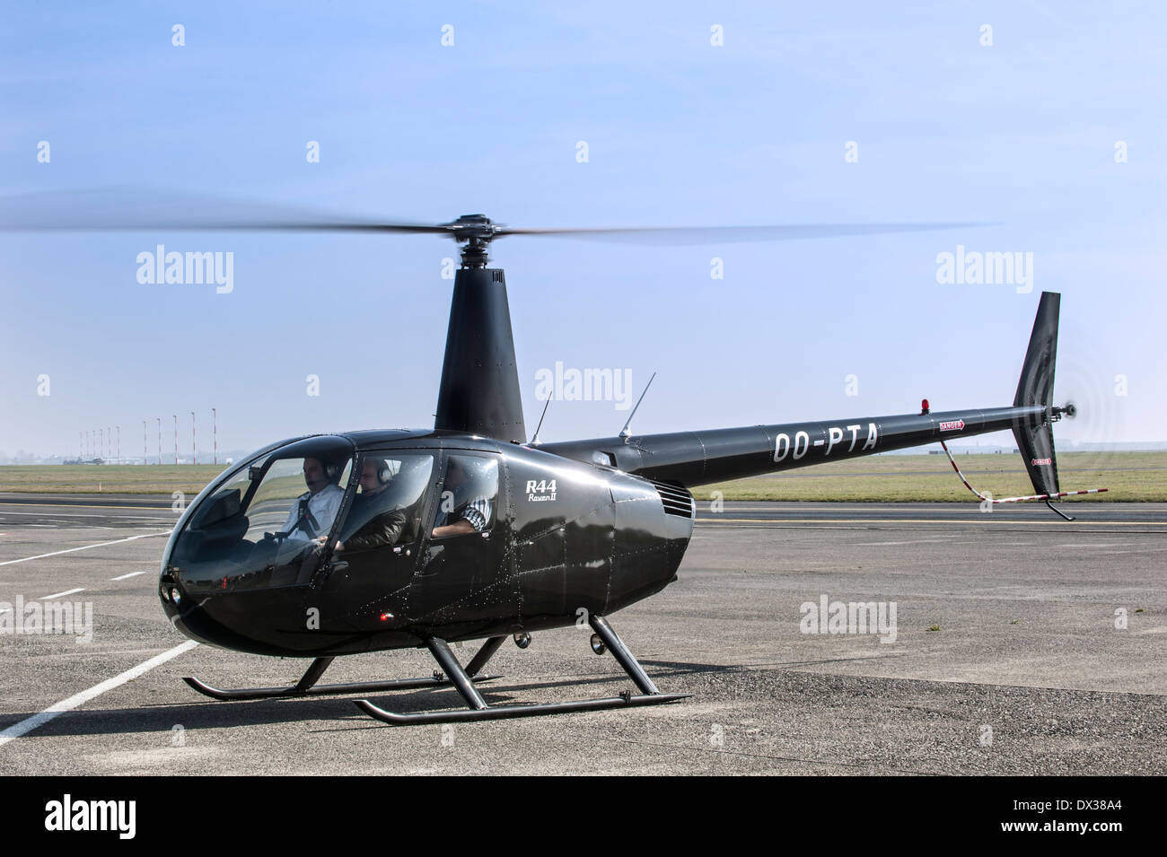 Robinson R44 Raven II, four-seat light single-engined helicopter with semi-rigid two-bladed main rotor and skid landing gear - Stock Image
