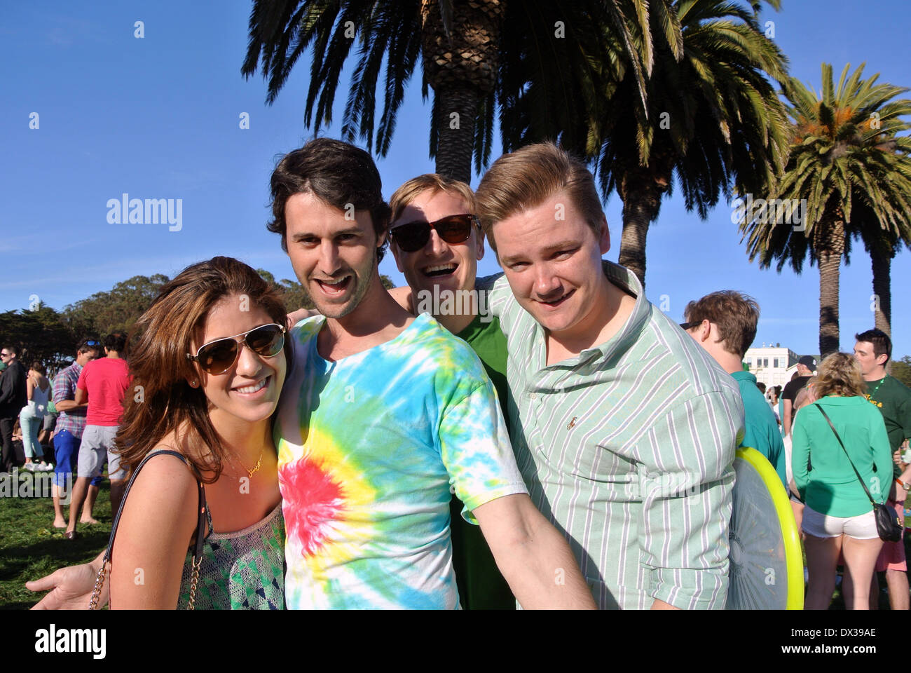 four young adults celebrate St. Patrick's day at Fort Mason - Stock Image