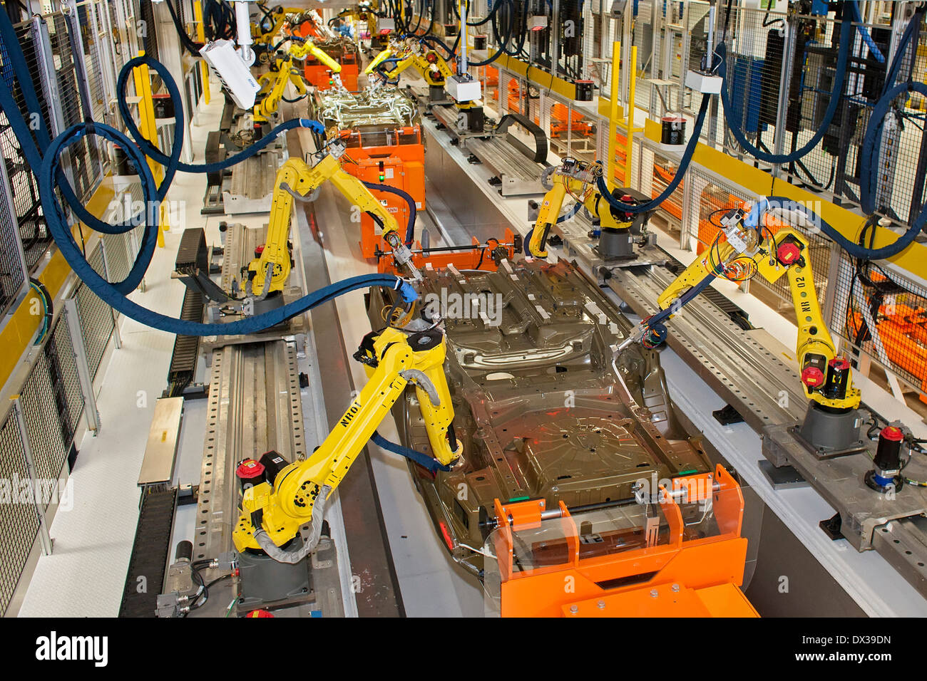 Robots in the underbody sealing and underbody coating station of the paint shop at Chrysler's Sterling Heights Assembly Stock Photo