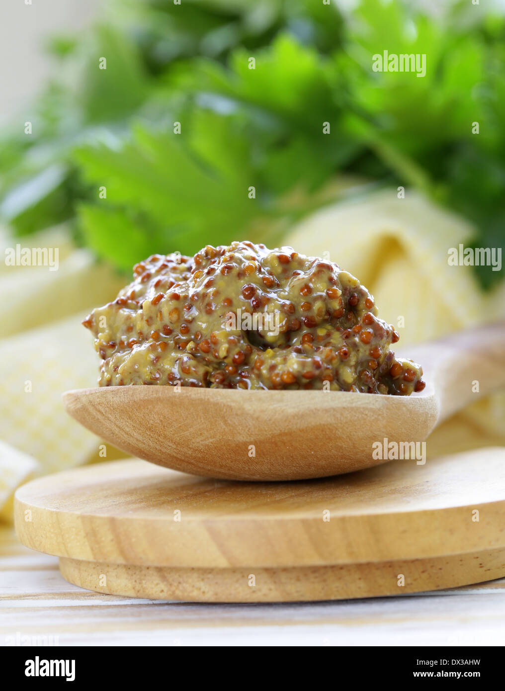 Traditional Dijon Mustard In A Wooden Spoon Stock Photo 67686357