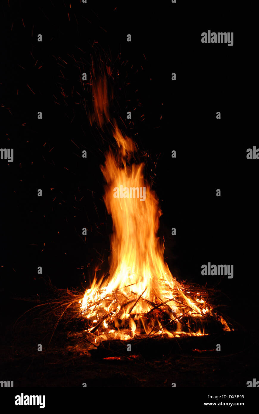 Red fire on black background - Stock Image