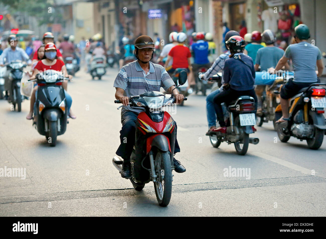 Vietnamese commuters on motorbikes in the Old Quarter of Hanoi. Hanoi, Vietnam, Southeast Asia - Stock Image