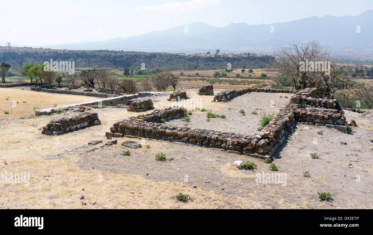 footprint of old building at crest of hill west of Patio 5 with sunken recessed access to 2 tombs in ruins of ancient city Yagul - Stock Image