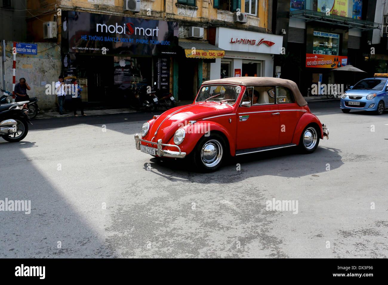 Red convertible Volkswagen beetle in Hanoi, Vietnam, Southeast Asia - Stock Image