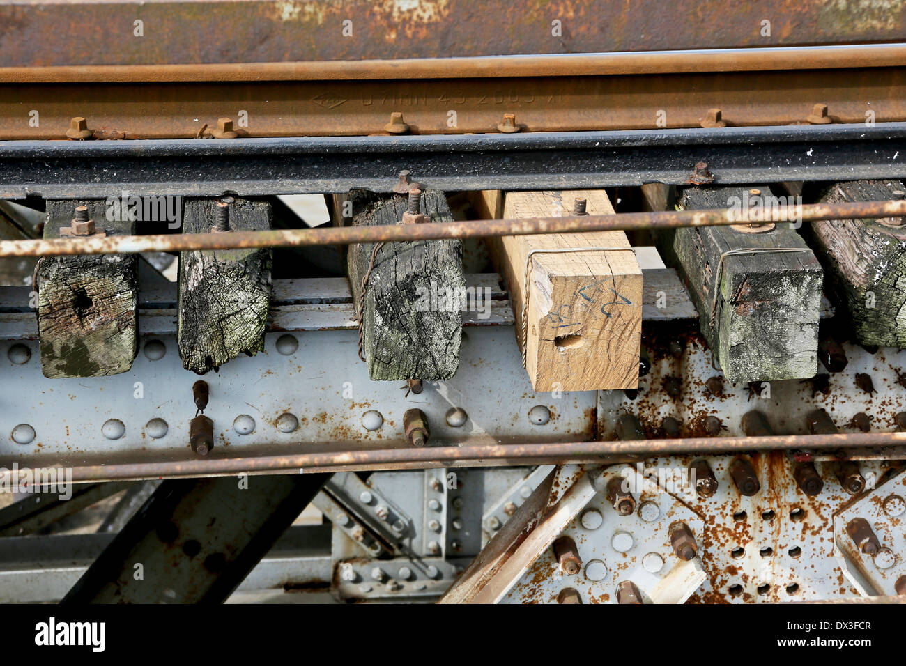 A newly replaced railway sleeper alongside decaying sleepers on the Long Bien Bridge. Hanoi, Vietnam, South East Asia - Stock Image
