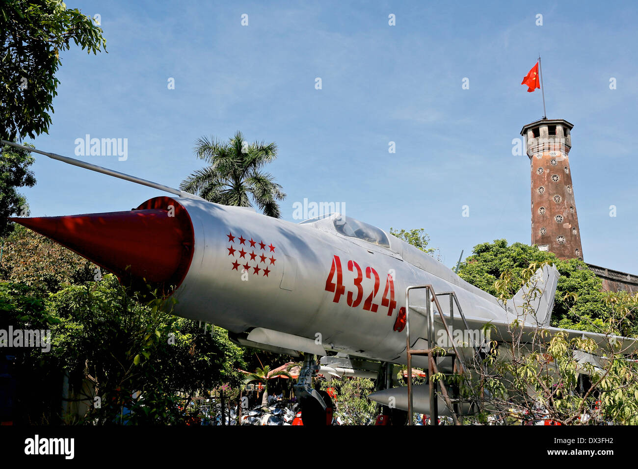 Vietnamese Air Force Mig 21  in front of the  hexagonal tower at the Vietnam Military History Museum, Vietnam, South - Stock Image