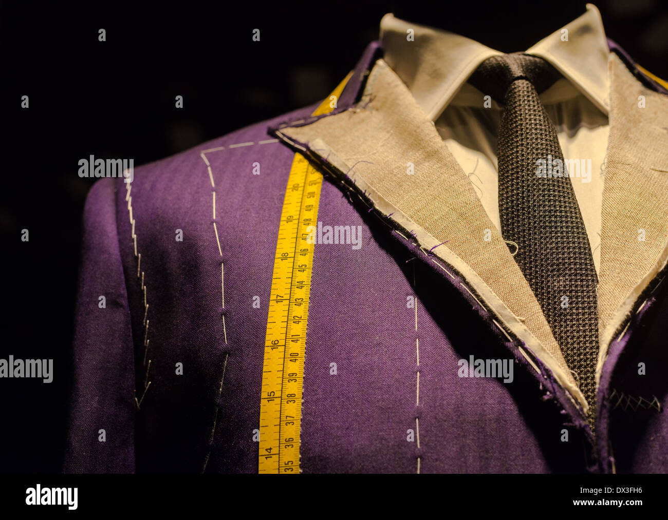 Work in Progress Suit on Mannequin with Yellow Tape Measure - Stock Image