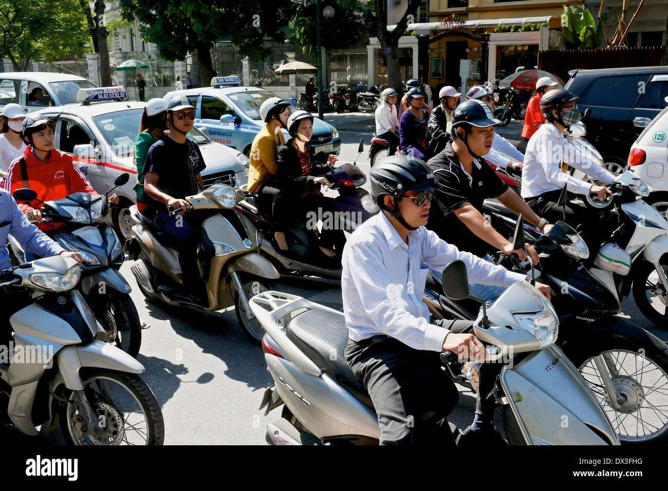 Motorbikes and taxis in a traffic jam in Hanoi. Hanoi, Vietnam, Southeast Asia - Stock Image