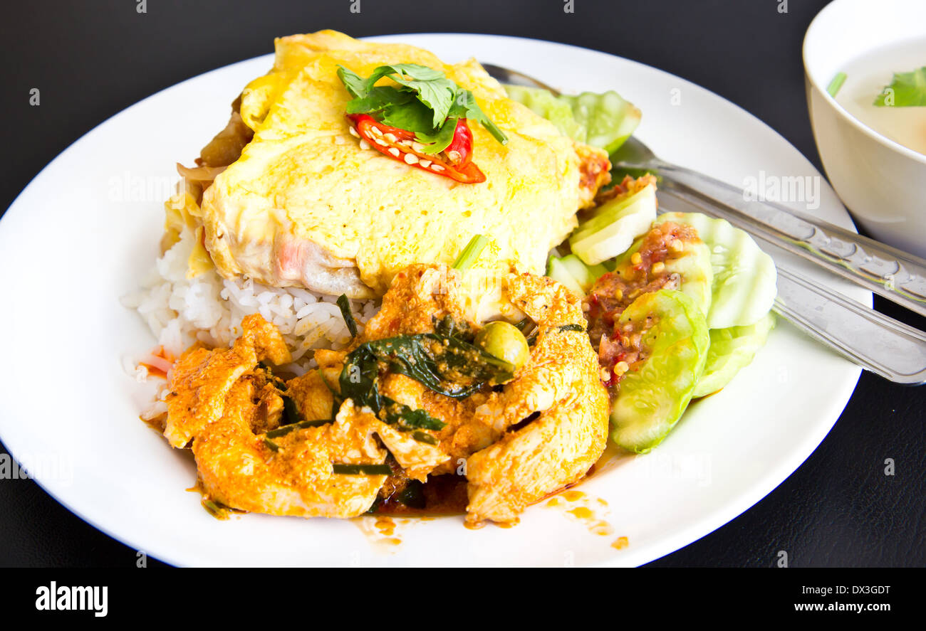 Spicy chicken curry and omelet with jasmine rice - Stock Image