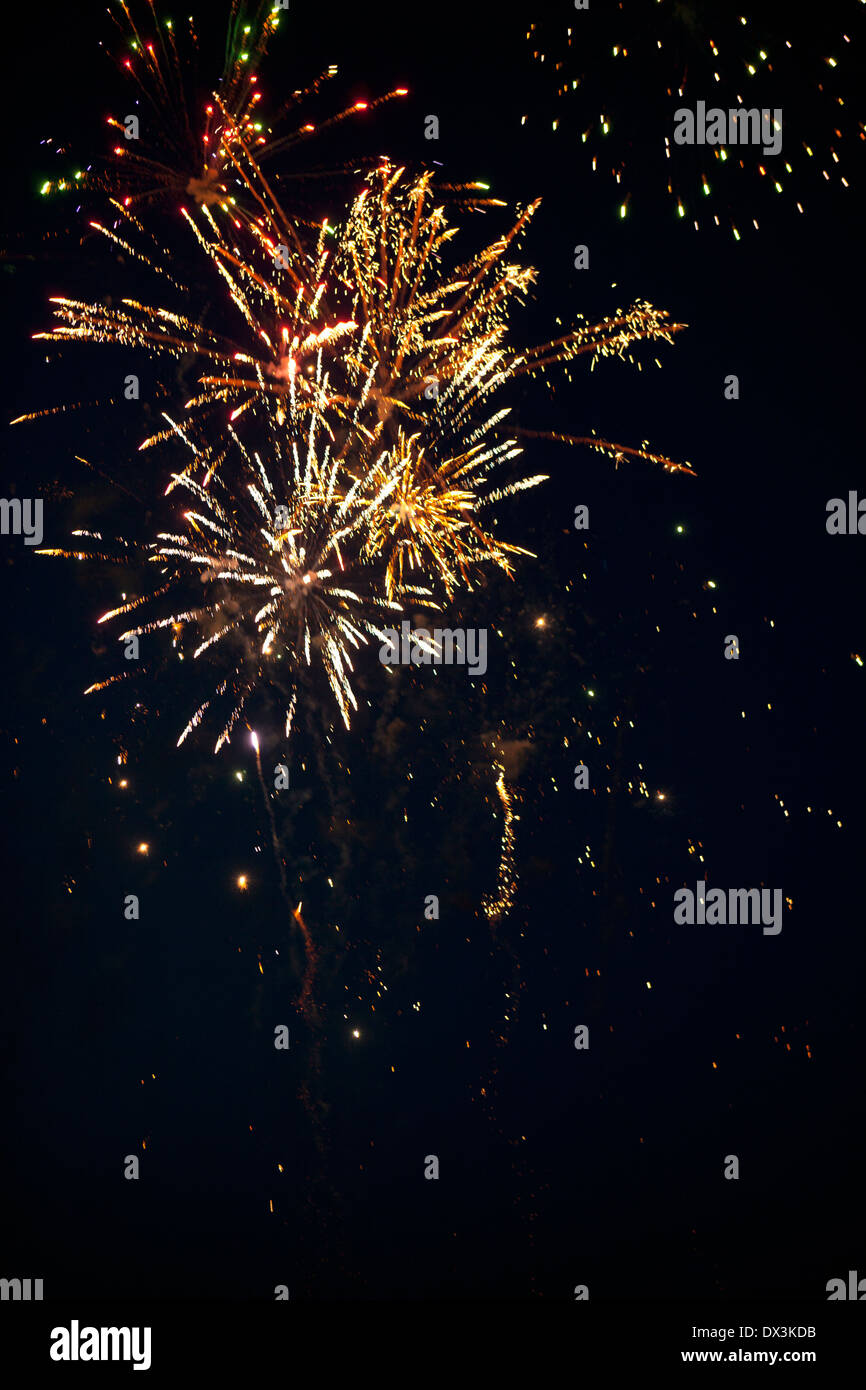Fireworks exploding in night sky, low angle view - Stock Image