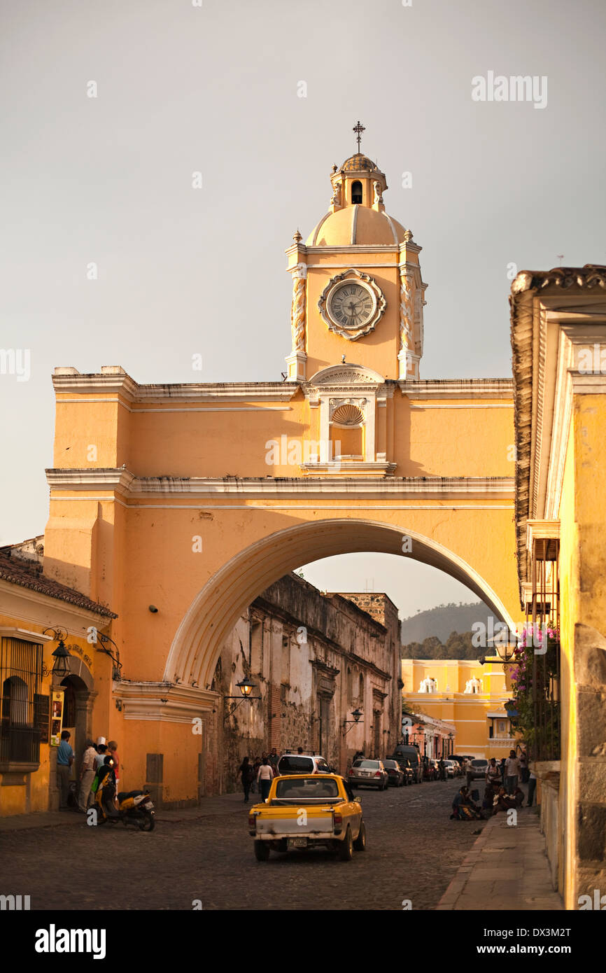 Sunny archway with clock and cupola, Antigua, Guatemala - Stock Image