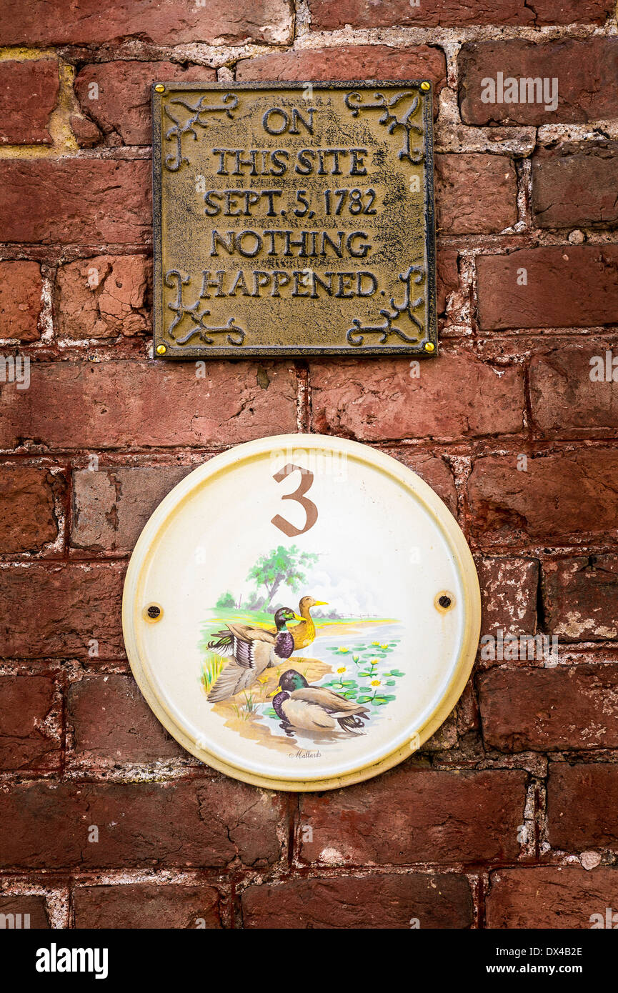 House plaque with nonsese claim above it in UK reporting that 'Nothing Happened' in 1782 on this site - Stock Image